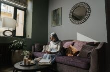 A woman sitting on a couch